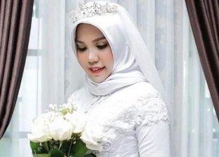 تنفيذا لوصية خطيبها.. تلتقط صورا بفستان زفافها بعد وفاته
