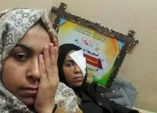 الفلسطينية الجريحةمي سليمان أبو رويضة وشقيقتها نرمين