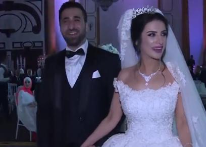 عروسان يختارن موسيقى لريال مدريد اثناء تقطيع التورتة
