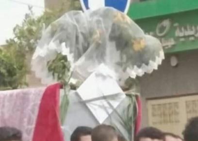 نعش عروس ههيا مزين بالطرحة والورود