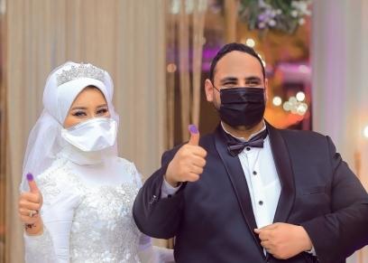 عروسان الكمامة
