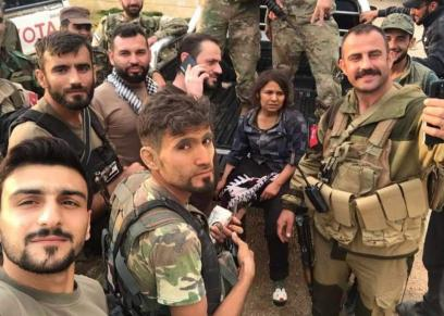 المقاتلة السورية وسط عناصر من فصائل تركيا