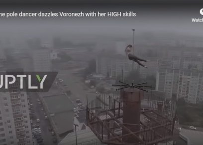 بالفيديو| رقصات خطيرة على عمود أعلى بناية في روسيا
