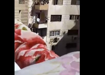 لحظة انتحار فتاة من الشرفة