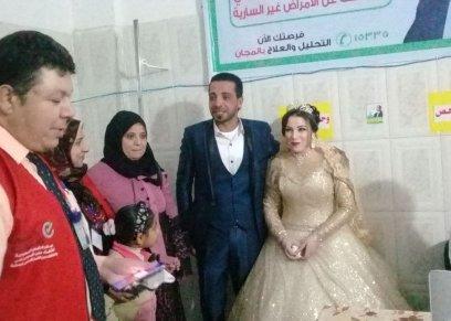 عروسان داخل مقر حملة فيروس سي