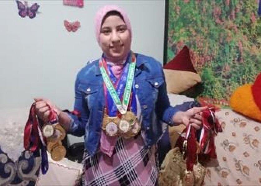 «رانيا».. تحدت العادات الريفية وحصدت 3 ميداليات فى بطولة العالم لرفع الأثقال