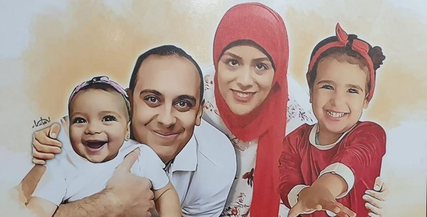 الشهيد محمد شلبي وأرملته وطفلتيه