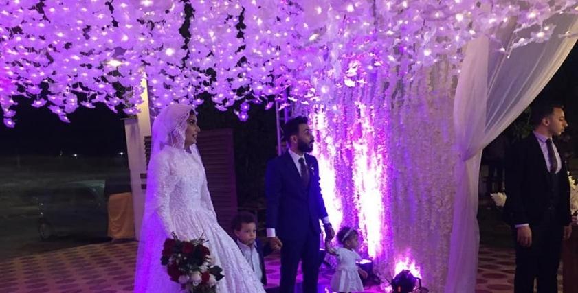 محمد وإيمان في قاعة الزفاف